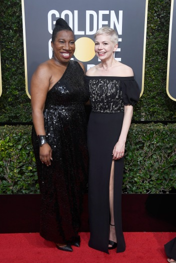 BEVERLY HILLS, CA - JANUARY 07: Activist Tarana Burke (L) and Michelle Williams attends The 75th Annual Golden Globe Awards at The Beverly Hilton Hotel on January 7, 2018 in Beverly Hills, California. (Photo by Frazer Harrison/Getty Images)
