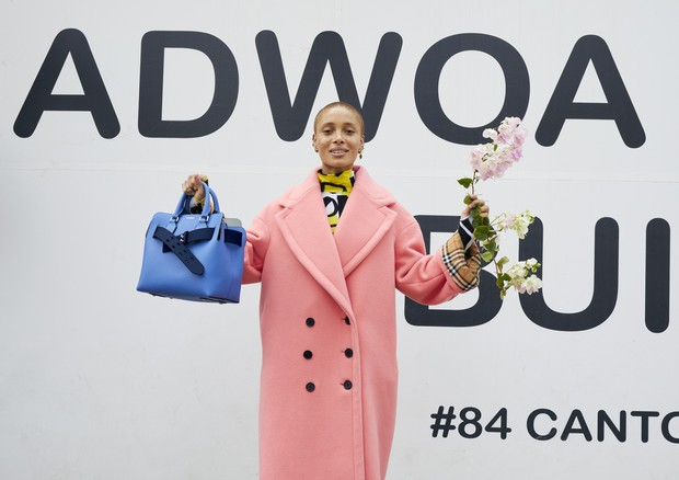 adwoa_aboah_in_a_coral_wool-cashmere_cocoon_coat_and_carrying_the_small_belt_bag_c_courtesy_of_burberry_juergen_teller