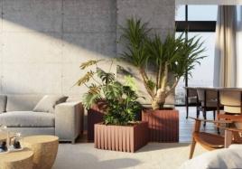 Apenas com um conjunto de vasos no canto da sala você pode mudar o clima da sua casa. Na foto, peças da coleção 'Ripados' do Studio André Lenza Foto: Caio Weber
